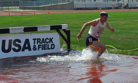Bob winning Bronze Medal at USA National Masters Track & Field Championships, 2000 Meter Steeplechase, Olathe KS July 12, 2013